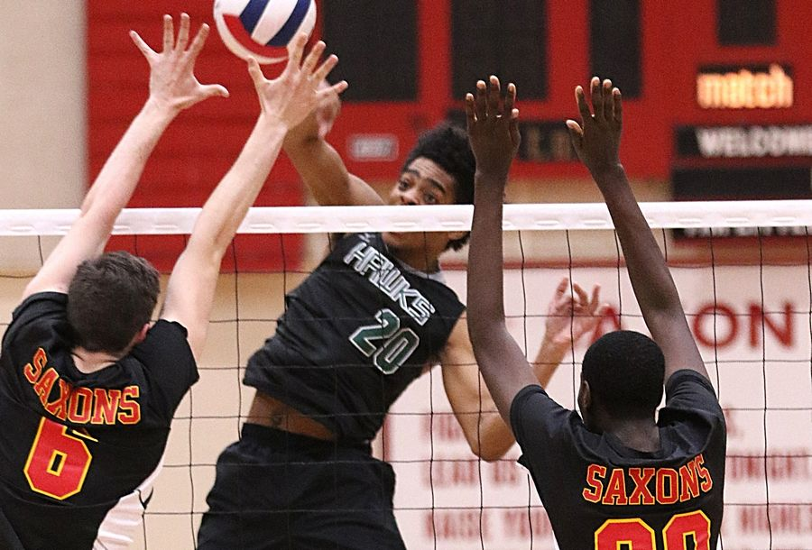 Bartlett's Toiyon Walton sends the ball during varsity boys volleyball at Schaumburg High School High School Wednesday night.