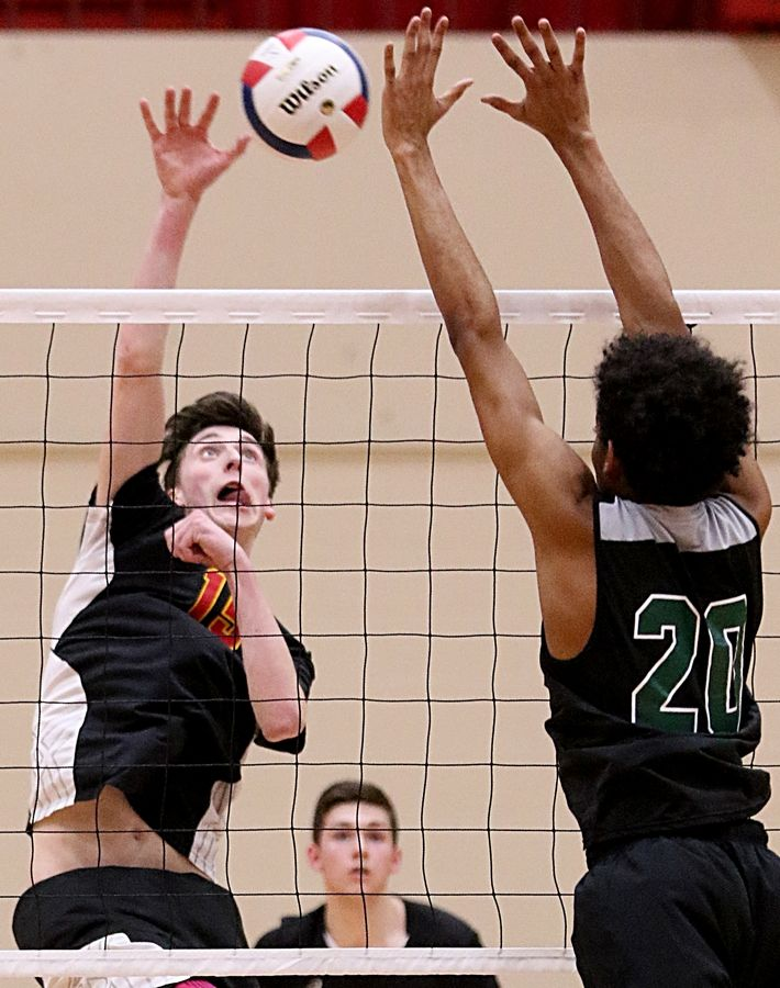 Schaumburg's Isaiah Mitchell hits the ball against Bartlett during varsity boys volleyball at Schaumburg High School High School Wednesday night.