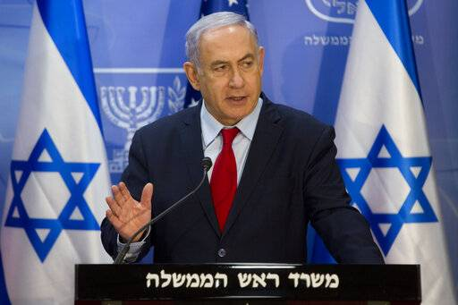 Israeli Prime Minister Benjamin Netanyahu gestures as he speaks during joint statements with U.S. Secretary of State Mike Pompeo at the Prime Minister's office in Jerusalem, Wednesday, March 20, 2019. Pompeo has given Israel's leader a welcome boost at the height of a tight re-election campaign. (AP Photo/Sebastian Scheiner, Pool)