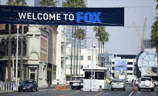 Cars enter and leave Fox Studios, Tuesday, March 19, 2019, in Los Angeles. Disney has closed its $71 acquisition of Fox's entertainment business on Wednesday, March 20, in a move set to shake up the media landscape. The closure paves the way for Disney to launch its streaming service, Disney Plus, due out later this year. (AP Photo/Chris Pizzello)