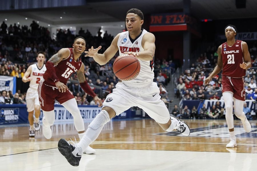 Belmont's Kevin McClain drives to the net to get two of his game-high 29 points to lead the Bruins to an 81-70 victory over Temple Tuesday in an NCAA tournament First Four game in Dayton, Ohio. Belmont meets Maryland Thursday in the East Regional in Jacksonville, Fla.