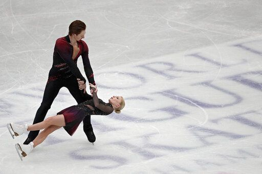 Russian Evgenia Tarasova and Vladimir Morozov perform during the pairs short program in the Japan World Figure Skating Championships at Saitama Super Arena in Saitama, north of Tokyo, Wednesday, March 20, 2019.