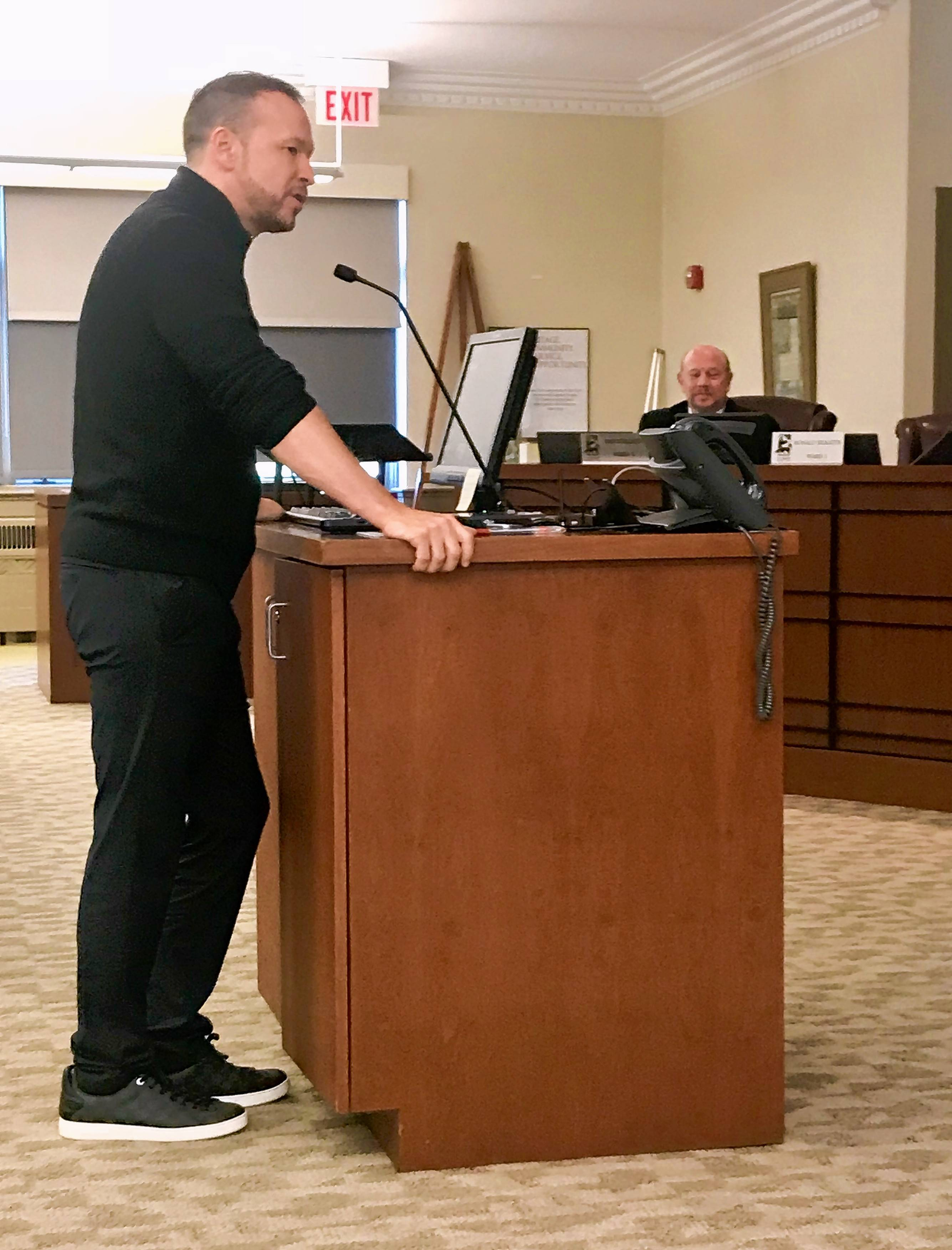 Actor Donnie Wahlberg addresses the St. Charles City Council last year about opening a Wahlburgers restaurant on the city's west side. The restaurant's groundbreaking is Friday.