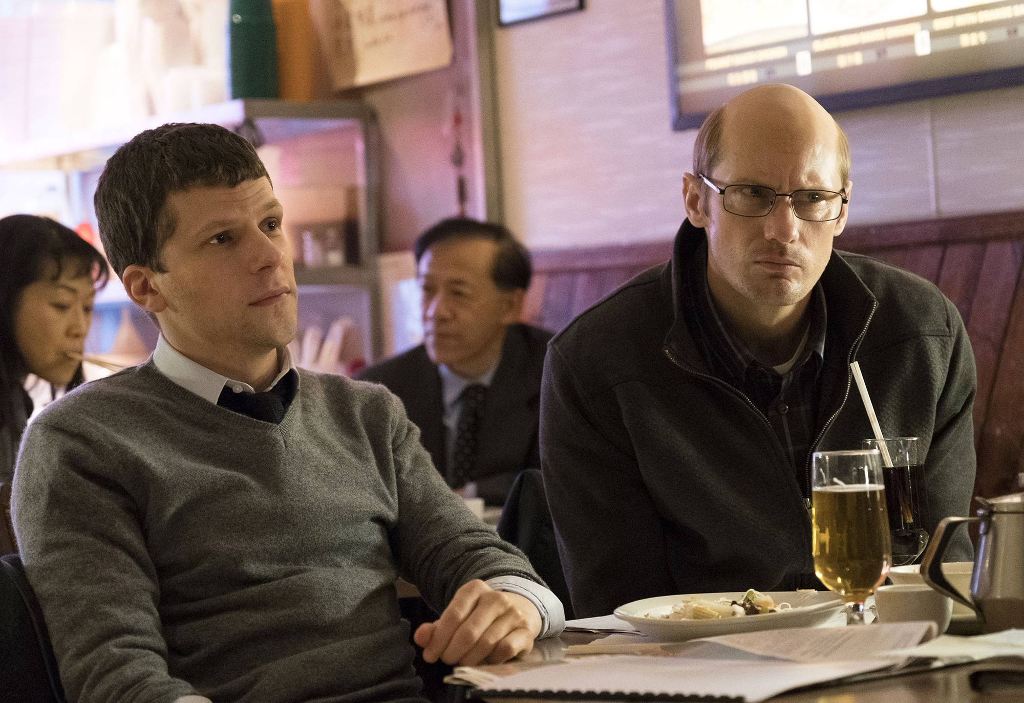 "Cousins (Jesse Eisenberg, left, and Alexander Skarsgard) plot a high-tech way to make a killing on the New York Stock Exchange in ""The Hummingbird Project."""