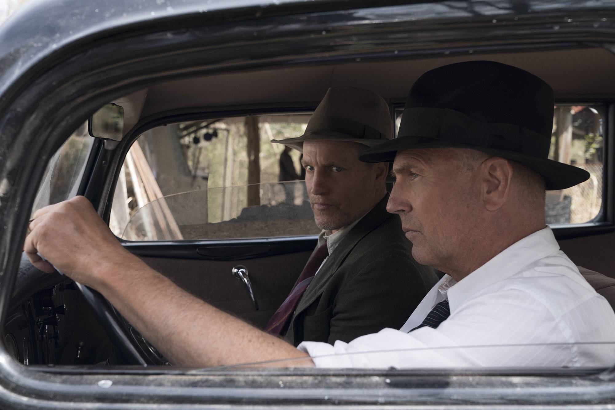 "Two former Texas Rangers (Woody Harrelson, left, and Kevin Costner) are brought out of retirement to hunt down outlaws Bonnie Parker and Clyde Barrow in ""The Highwaymen."""