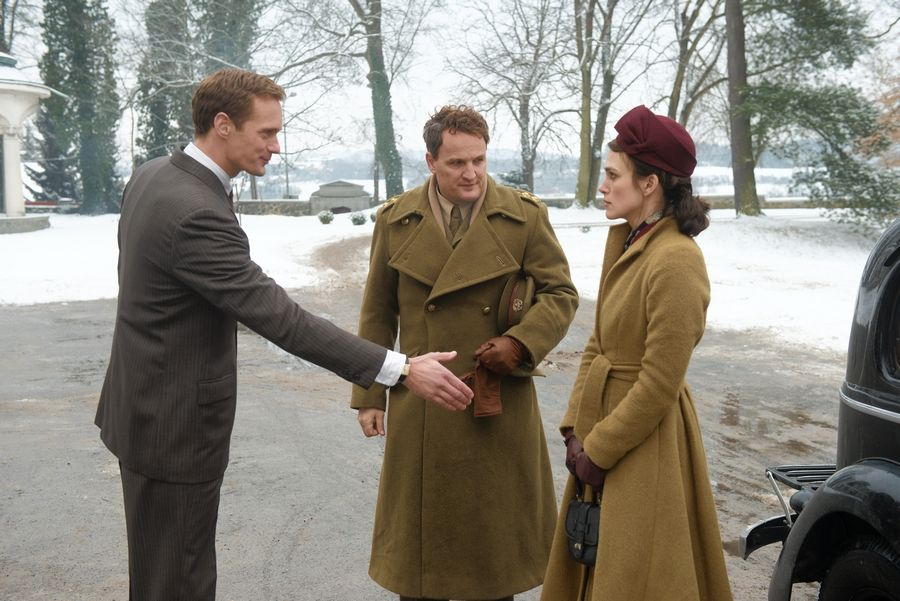 "A German architect (Alexander Skarsgård) welcomes Colonel Morgan (Jason Clarke) and his wife Rachael (Keira Knightley) to his house in James Kent's ""The Aftermath."""