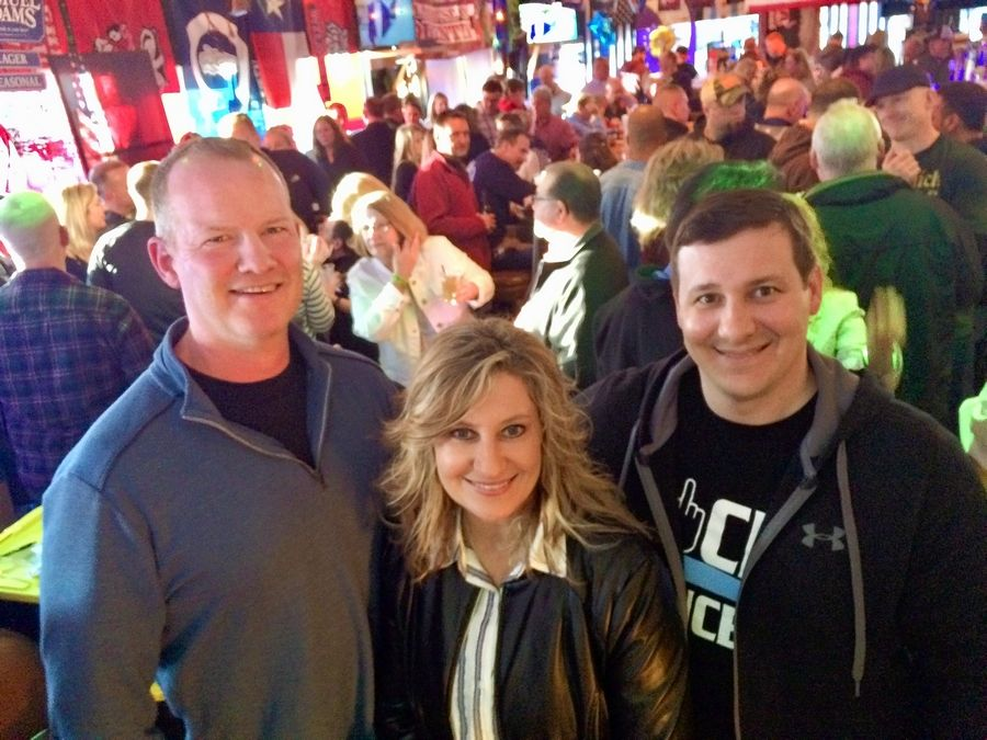 Dan Collins, left, of the nonprofit Heroes Family Fund, joins Kimberly Dahlem and her brother, Mike Kacen, at Oak Alley Saloon in Palatine. Dahlem's husband, Mark, who was a Palatine police officer, died of brain cancer in February, and the evening was a fundraiser to aid in their children's education.
