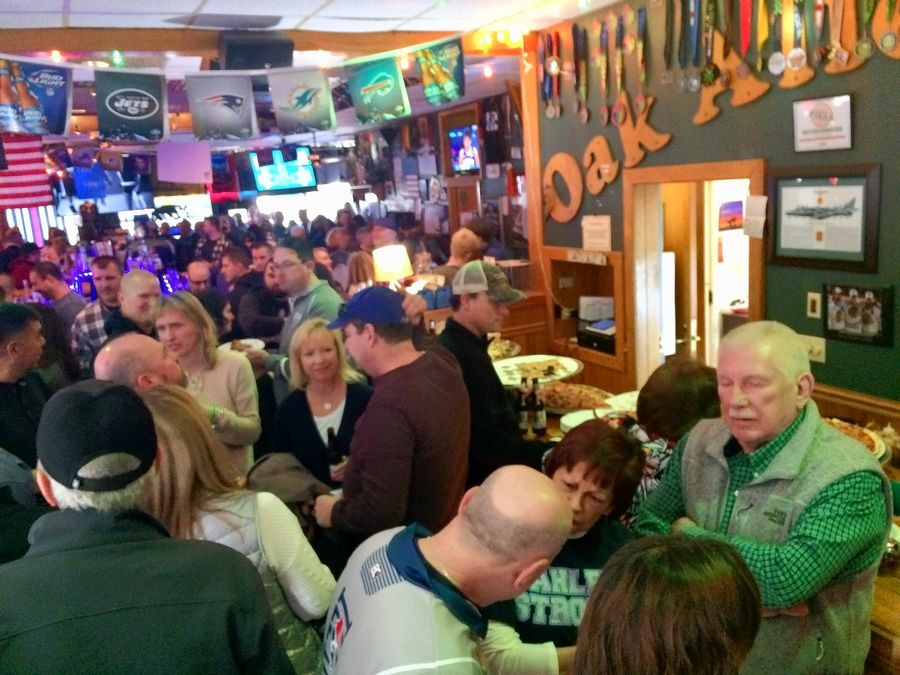 Oak Alley Saloon in Palatine was packed Thursday night for a fundraiser to benefit an education fund for the children of village police officer Mark Dahlem, who died of brain cancer in February.
