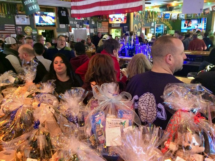 Oak Alley Saloon in Palatine was jammed Thursday night for a fundraiser to benefit an education fund for the children of village police officer Mark Dahlem, who died of brain cancer in February. The evening included raffle prizes seen here.