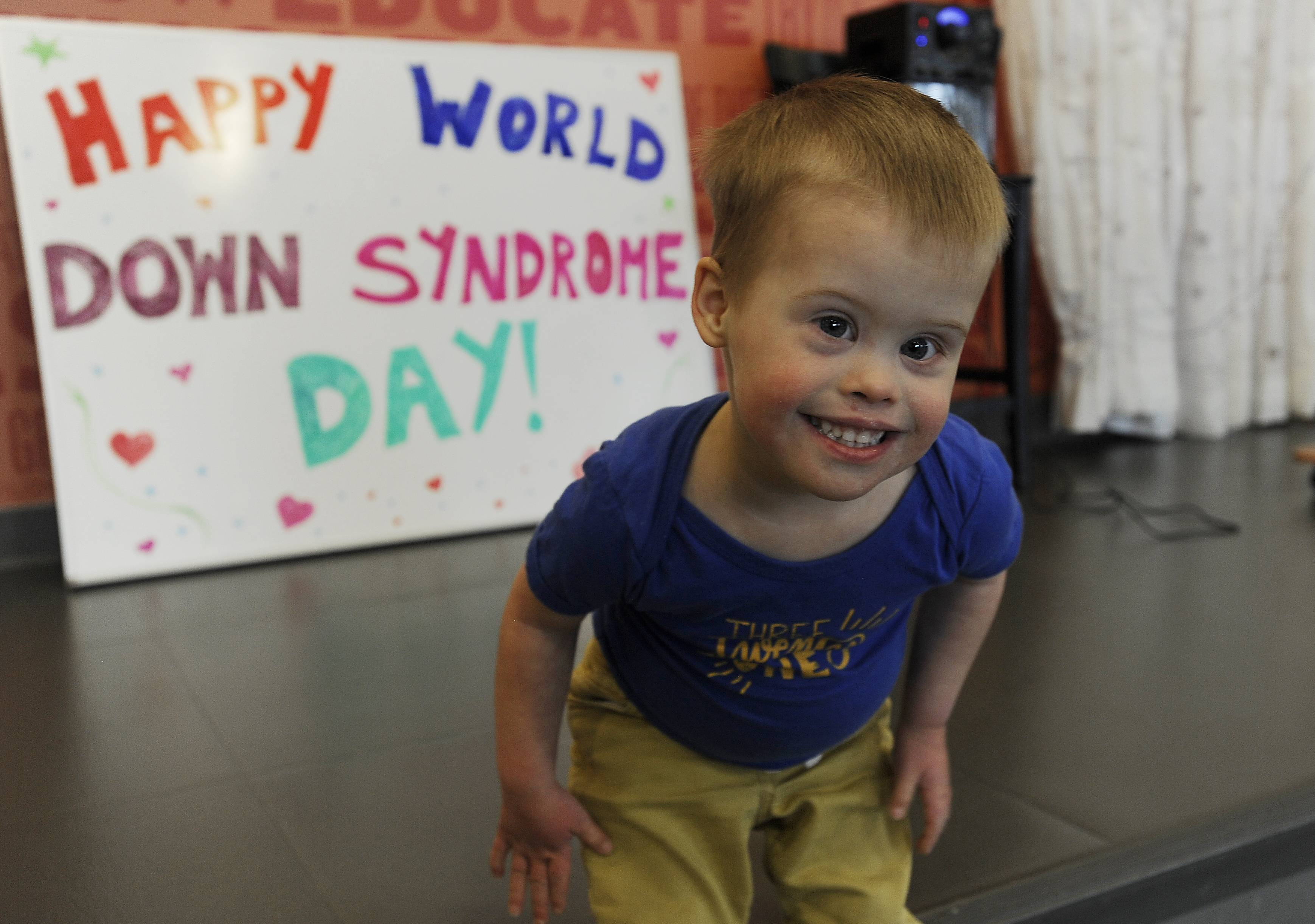 Cody Binger, 3, of Huntley dances to the music Thursday as he celebrates himself on World Down Syndrome Day at GiGi's Playhouse in Hoffman Estates.