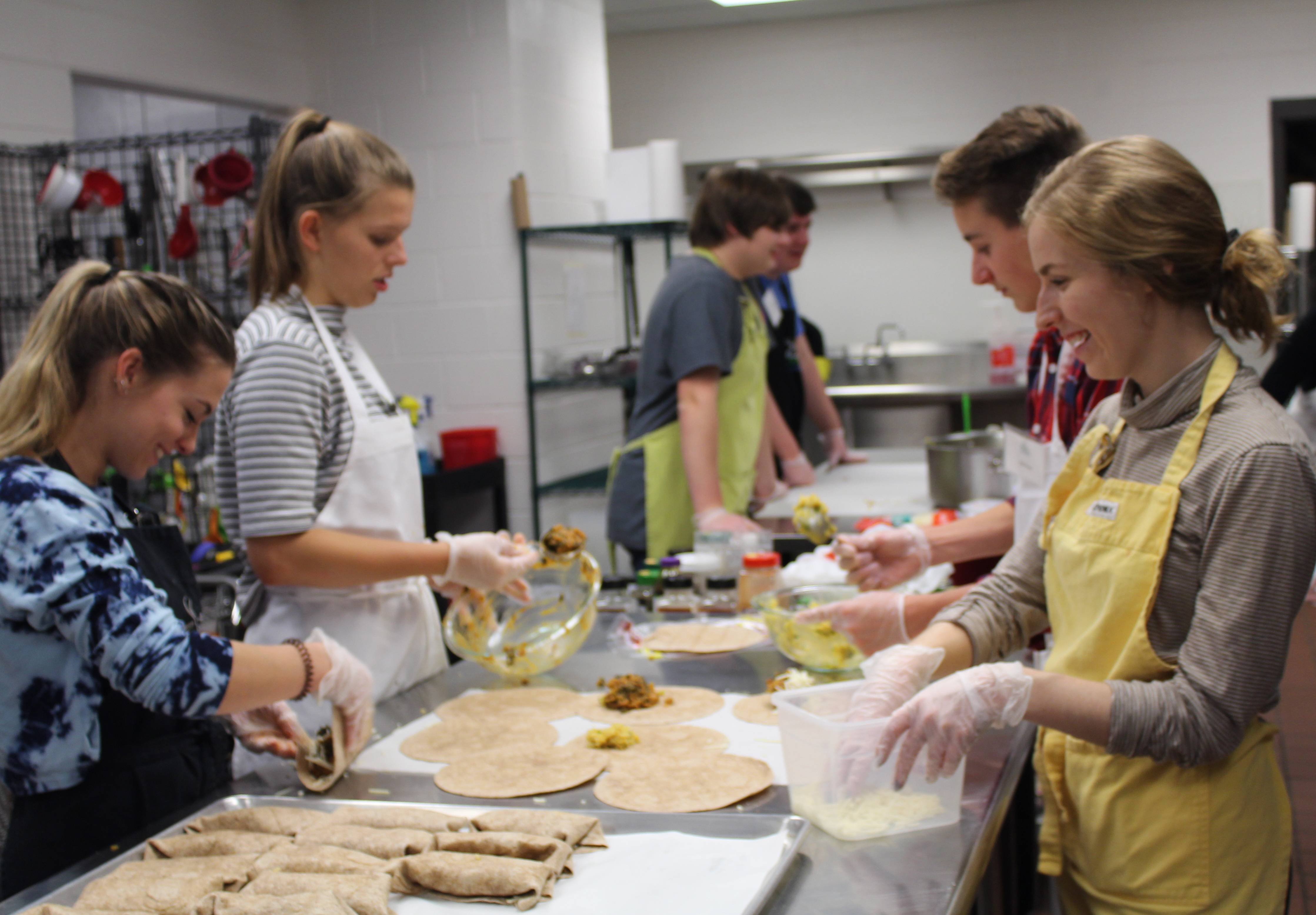 Kitchen mentor Sarah Wais, on right, works with high school students in the Fox Valley Food for Health kitchen in preparing healthy meals for those suffering from cancer and other illnesses. The nonprofit will hold a Spring Market on March 30 in Geneva to showcase healthy foods and food-related businesses.