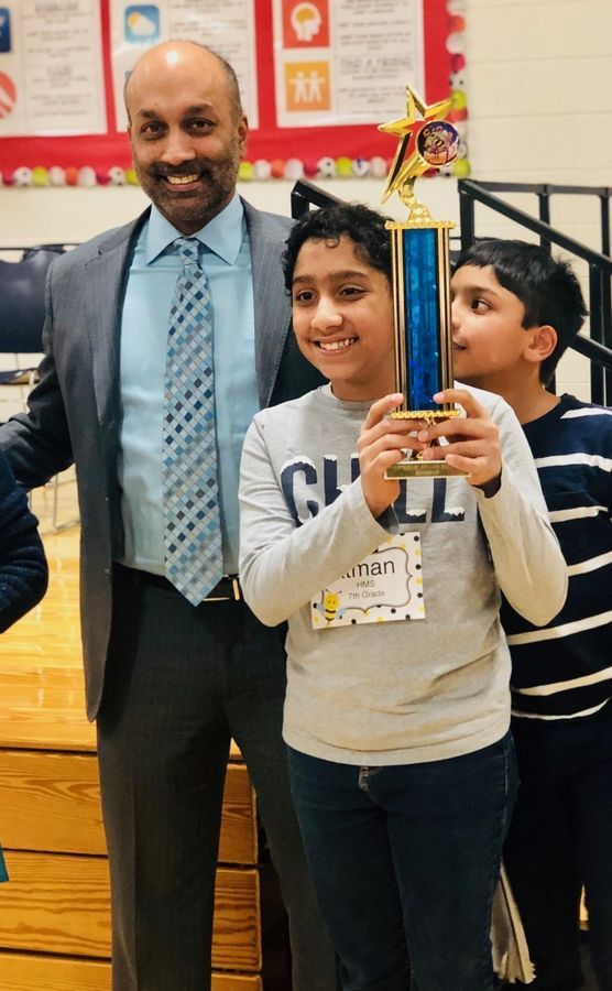 Atman Balakrishnan, a seventh-grader at Hinsdale Middle School, with his father, Balu Natarajan, the 1985 national spelling bee champion, after winning the DuPage County regional spelling bee last month. Atman will compete for the second time at nationals in May.