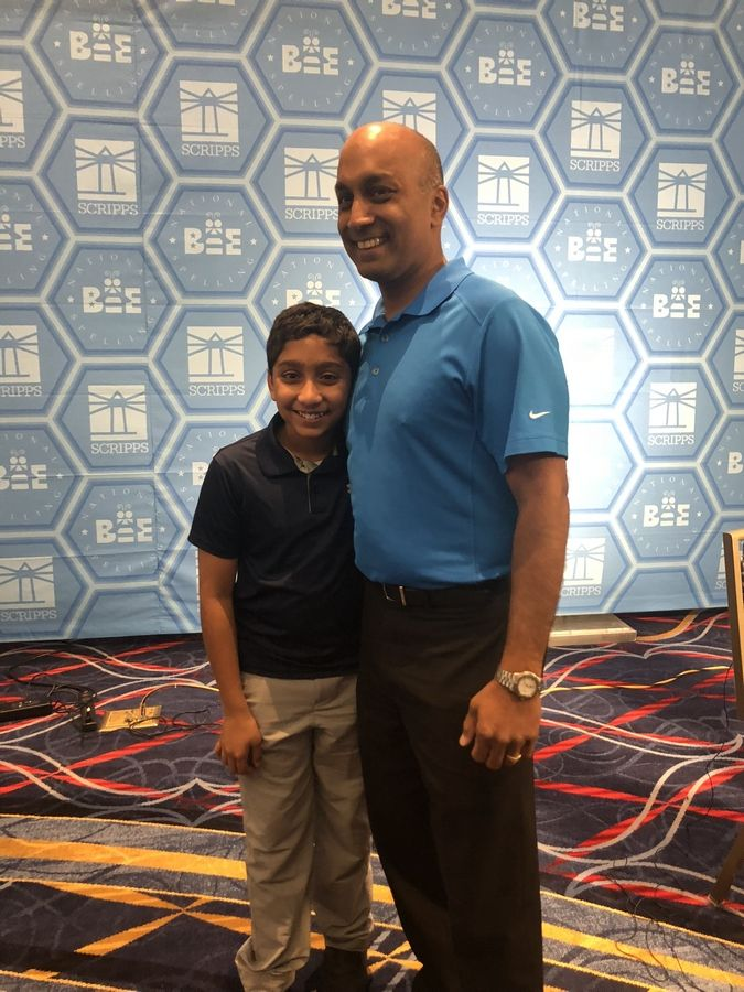 Atman Balakrishnan, a seventh-grader at Hinsdale Middle School, with his father, Balu Natarajan, the 1985 spelling bee champion, during last year's Scripps National Spelling Bee. Atman will compete for the second time at nationals in May.