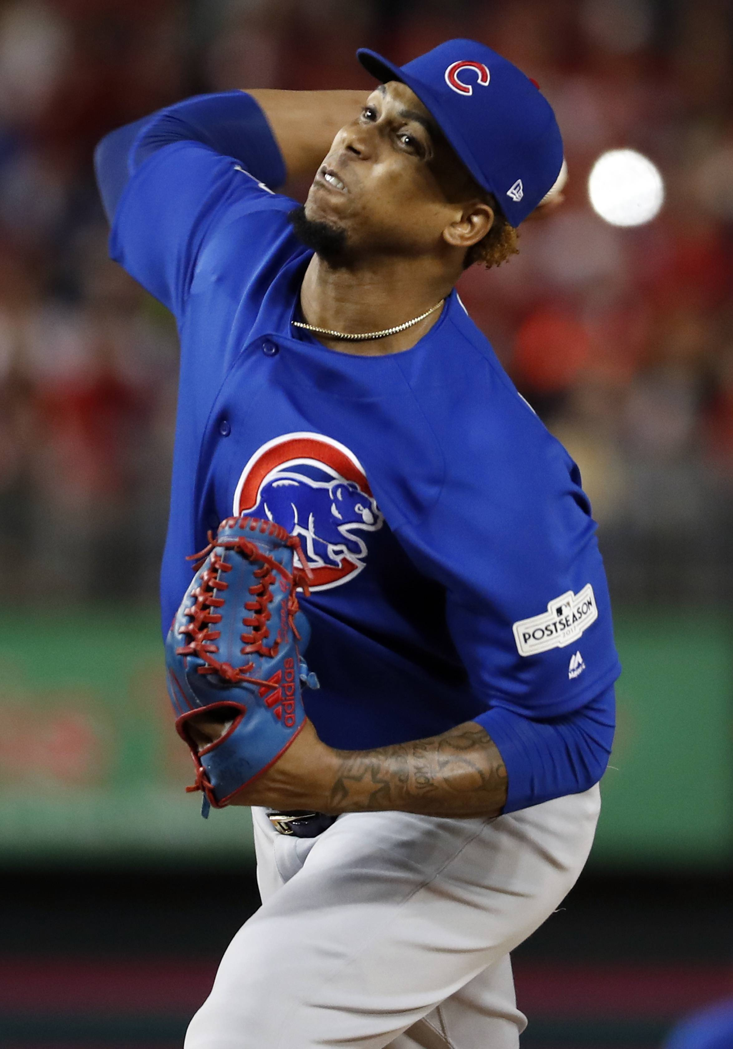 Chicago Cubs relief pitcher Pedro Strop throws during the sixth inning in Game 5 of baseball's National League Division Series against the Washington Nationals, at Nationals Park, Thursday, Oct. 12, 2017, in Washington.