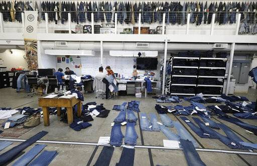 FILE- This Feb. 9, 2018 photo shows workers at Levi's innovation lab in San Francisco. On Thursday, March 21, 2019, Levi Strauss & Co. is going back to the public markets after 34 years.