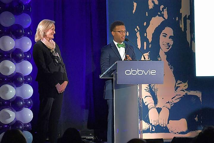 AbbVie's Laura Schumacher and Neal Math & Science Academy Principal Wayne Williams announce the pharmaceutical company's $40 million donation to rebuild the school Thursday.