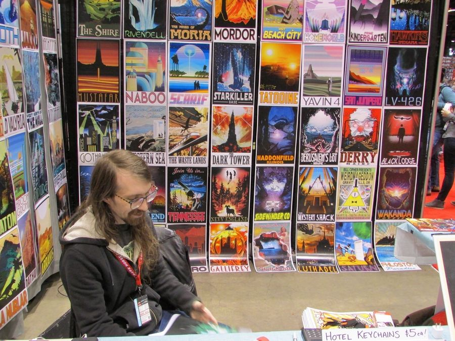 Evan Scola of Rocket Pop Inc. sells pop culture-inspired travel posters Friday at the C2E2 convention at McCormick Place in Chicago.