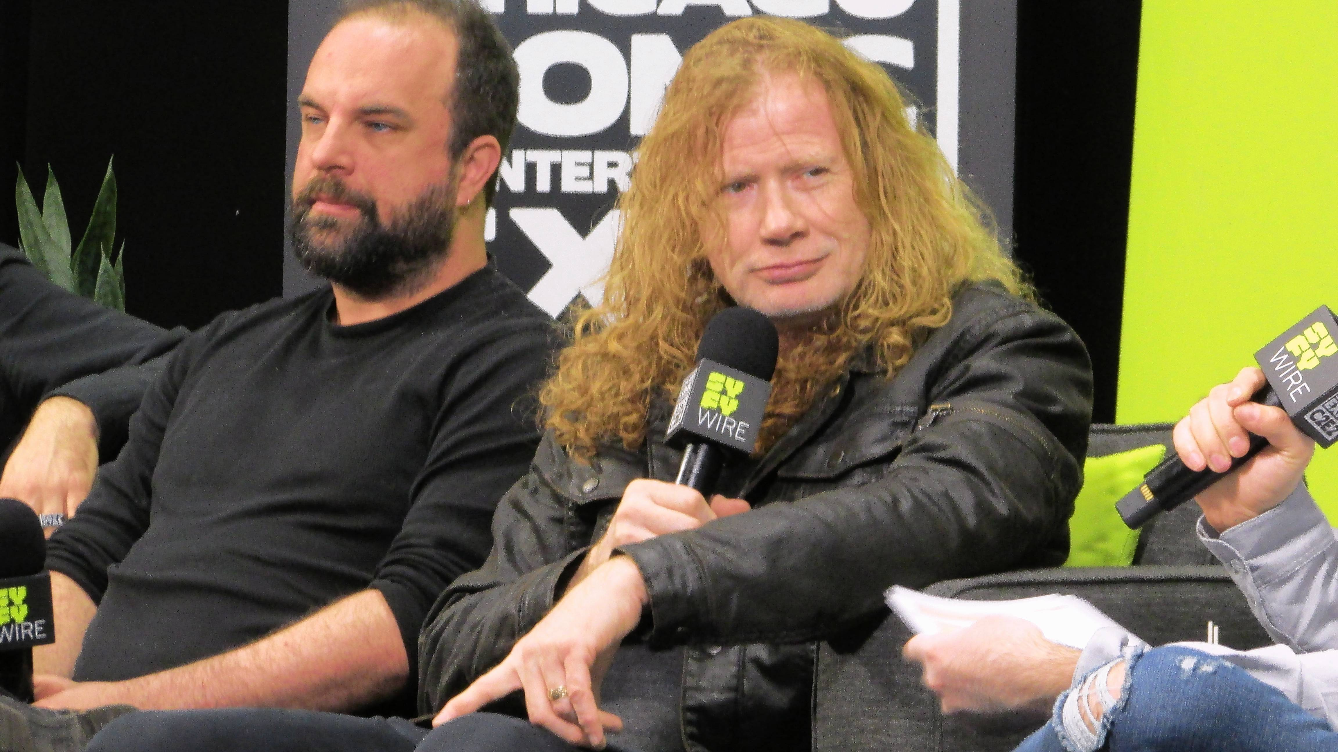 Megadeth frontman Dave Mustaine, right, and Heavy Metal Comics managing editor Tim Seeley talk about their comic-book collaboration Friday at the SyFy Wire stage at C2E2 in Chicago.
