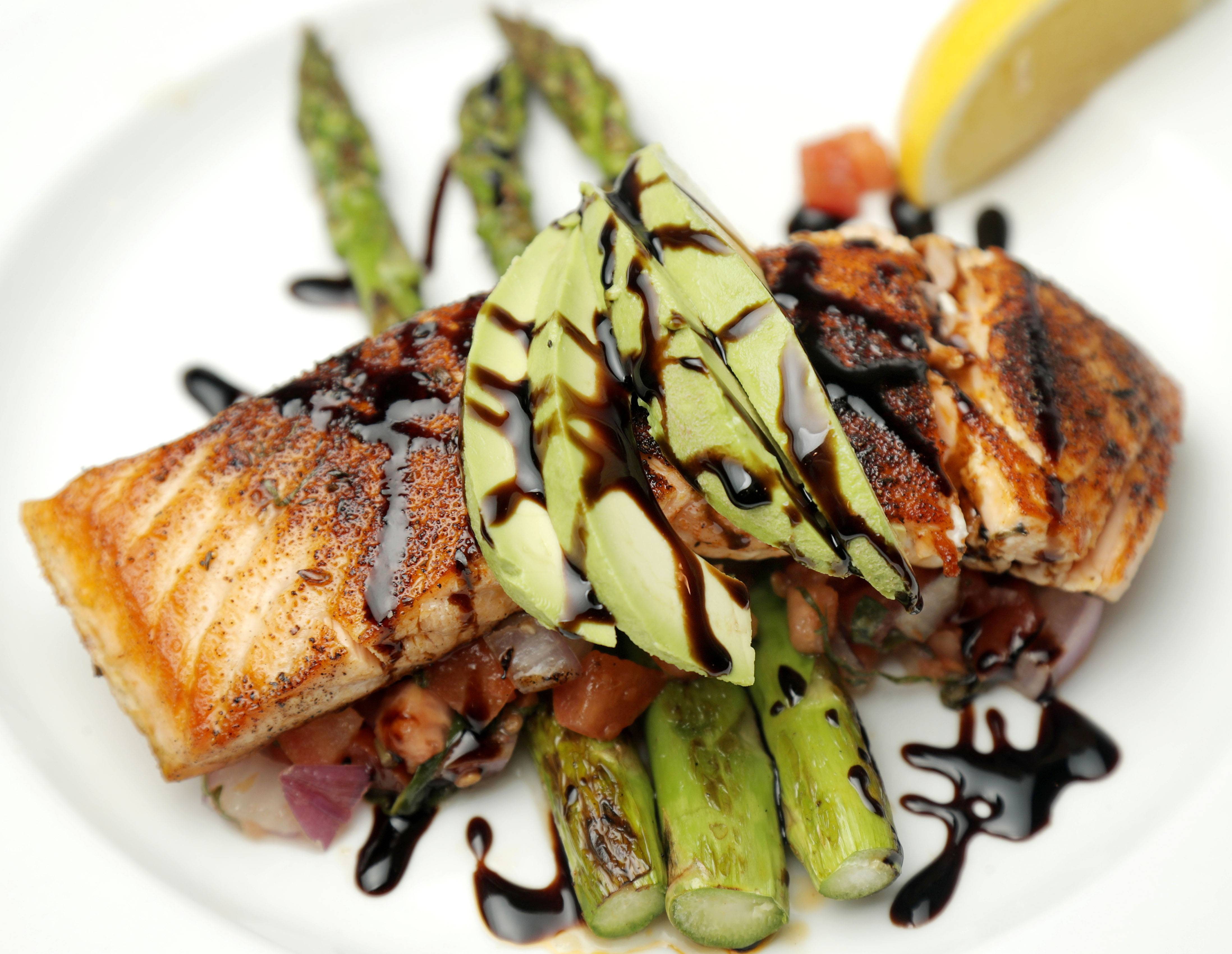 Scotty's on 21 serves up Francisco's salmon with grilled asparagus, avocado, diced tomato, red onion and balsamic glaze at the Vernon Hills restaurant.