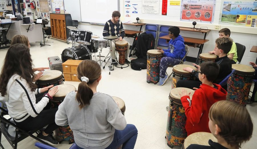 Tommy Carroll of Chicago plays the drums with seventh-graders in a jam session as Glen Crest Middle School held a disability awareness week in Glen Ellyn. Carroll is blind.