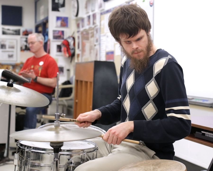 Tommy Carroll, a Chicago-based musician who is blind, gives a drum clinic during Glen Crest Middle School's first Disability Awareness Week at the Glen Ellyn school.