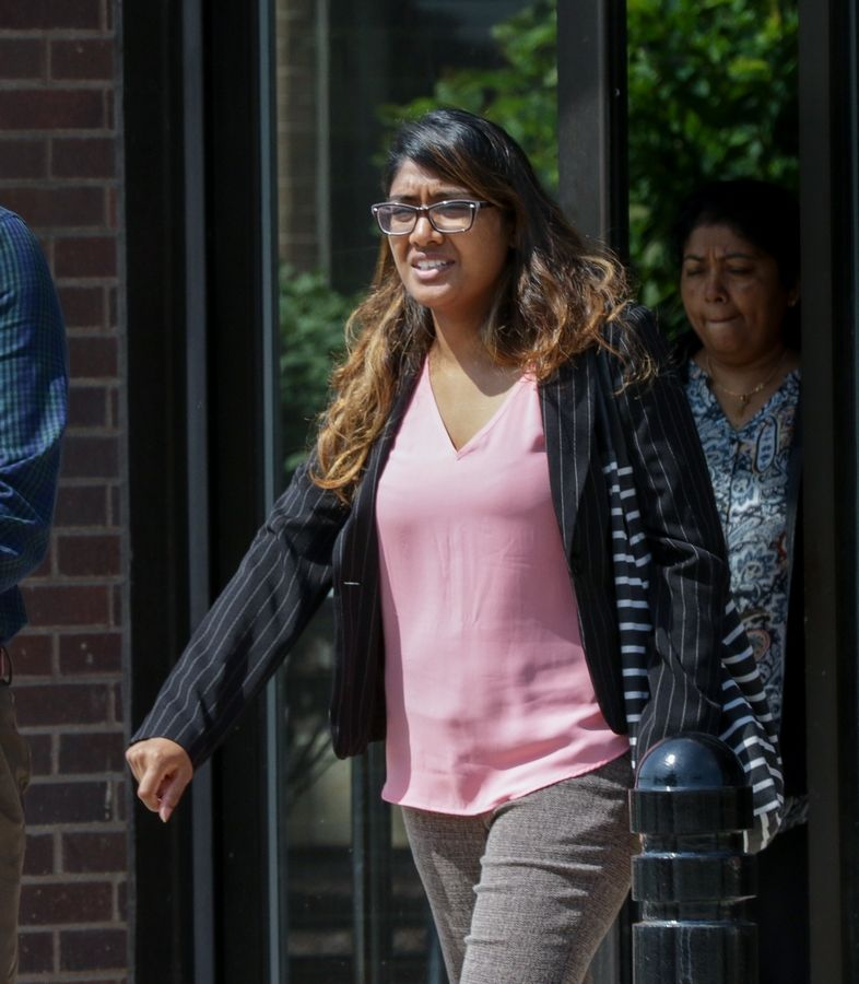 Tina Jones walks out of the DuPage County courthouse in Wheaton, after pleading not guilty to solicitation of murder and attempted murder during her arraignment last spring.