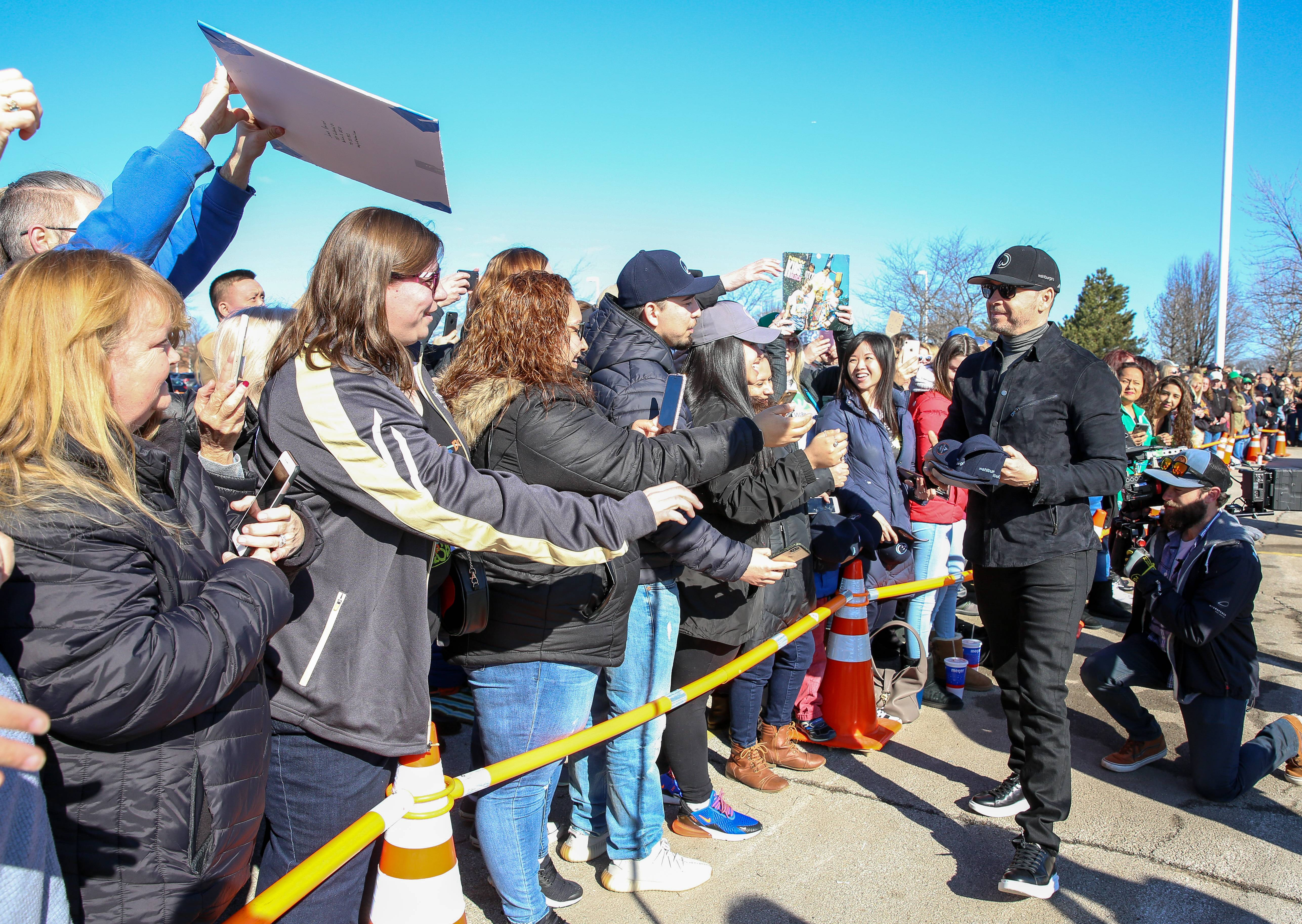 Donnie Wahlberg greets fans during Friday's groundbreaking of the new Wahlburgers restaurant in St. Charles.