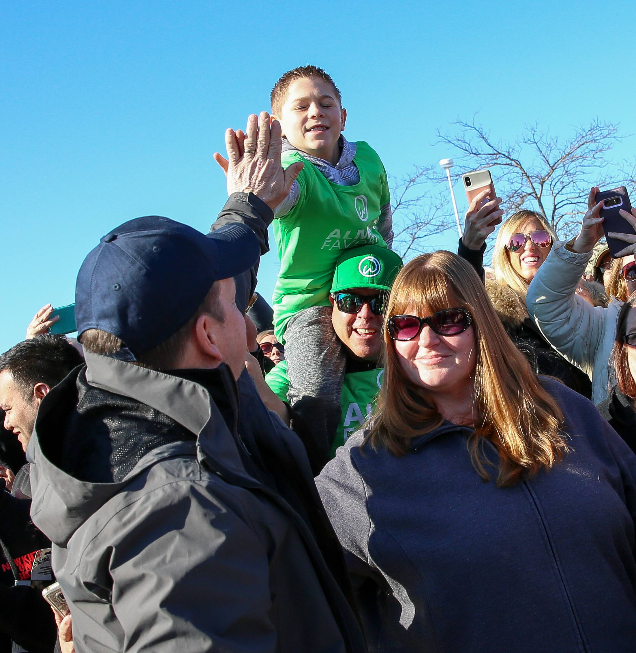 Dallas Ran, 10, gets a high-five from Paul Wahlberg at the groundbreaking of the new Wahlburgers restaurant in St. Charles on Friday. Paul Wahlberg is the executive chef of Wahlburgers restaurant chain he owns with brothers Mark and Donnie.