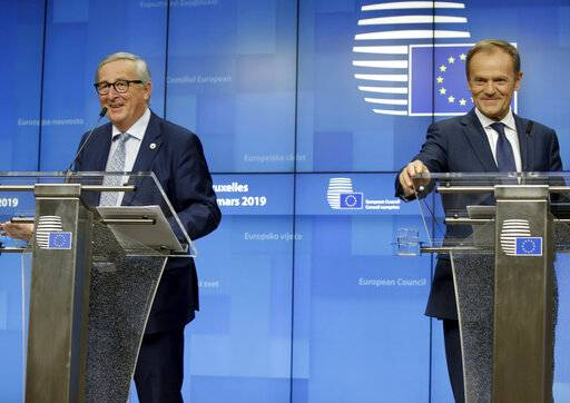 European Council President Donald Tusk, right, and European Commission President Jean-Claude Juncker participate in a media conference at an EU summit in Brussels, Thursday, March 21, 2019. Worn down by three years of indecision in London, EU leaders on Thursday were grudgingly leaning toward giving the U.K. more time to ease itself out of the bloc. (AP Photo/Olivier Matthys)