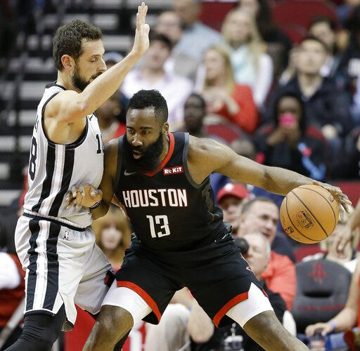 05fb74dc7a63 Houston Rockets guard James Harden (13) dribbles as San Antonio Spurs guard  Marco Belinelli