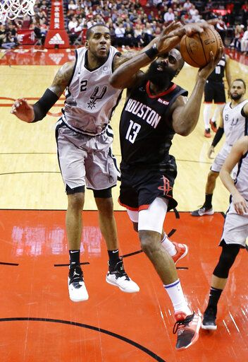 453589723e27 Houston Rockets guard James Harden (13) drives to the basket as San Antonio  Spurs