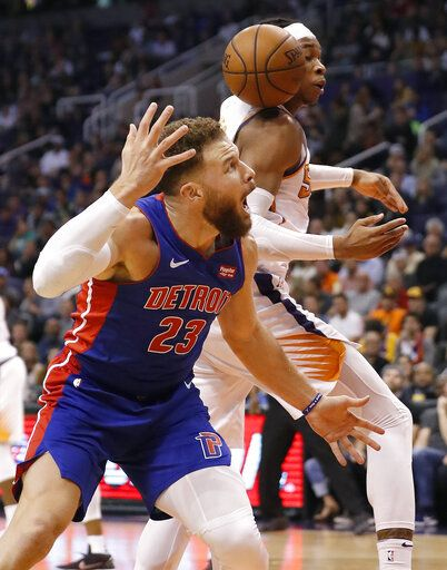 Phoenix Suns forward Richaun Holmes and Detroit Pistons forward Blake  Griffin (23) look for 7b899fe7b