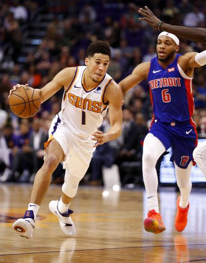 Phoenix Suns guard Devin Booker (1) drives as Detroit Pistons guard Bruce  Brown ( bba6f7ffc