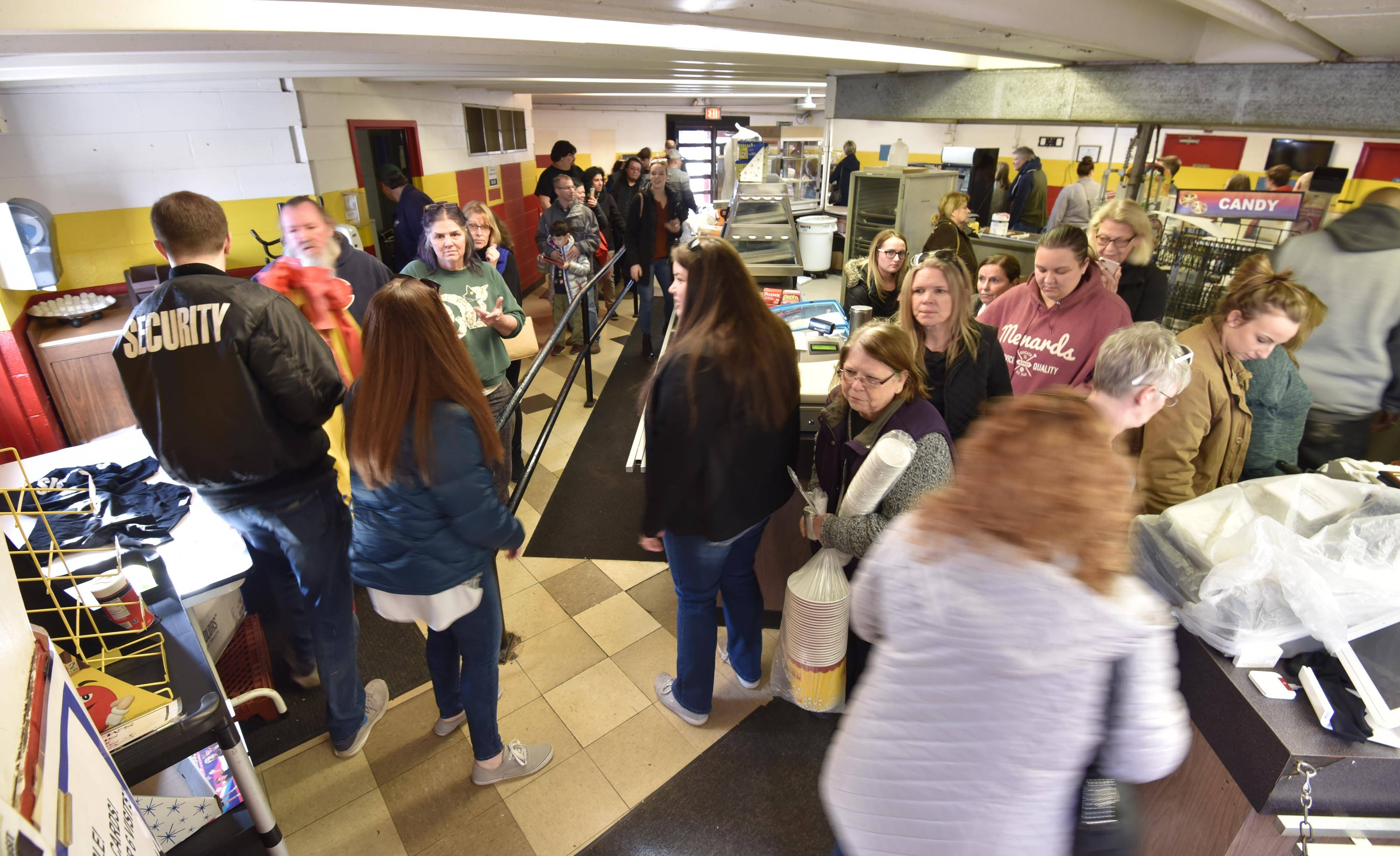 People wandered around the concession stand Saturday hoping to take home a piece of nostalgia at the Cascade Drive-In theater in West Chicago. The business is closing after 57 years.