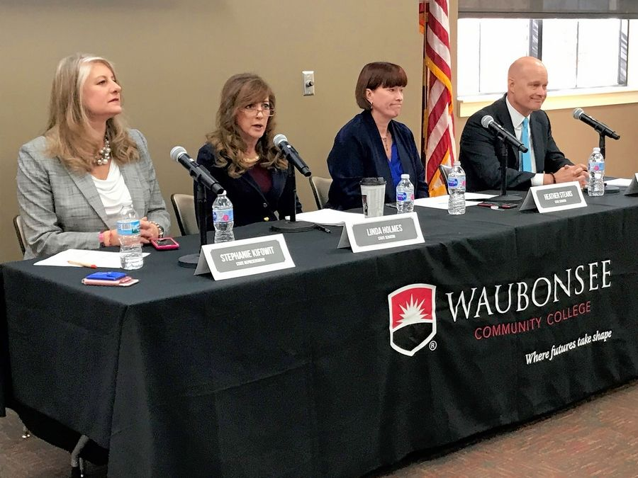 State Rep. Stephanie Kifowit of Oswego, from left, state Sen. Linda Holmes of Aurora, state Sen. Heather Steans of Chicago and Kane County State's Attorney Joe McMahon took part in a town hall about the legalization of marijuana Saturday in Aurora.