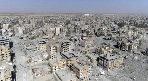 FILE - In this Thursday, Oct. 19, 2017 file photo, a frame grab made from drone video shows damaged buildings in Raqqa, Syria.
