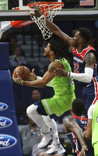 Minnesota Timberwolves' Derrick Rose, left, eyes the basket as Washington Wizards' Jeff Green defends in the second half of an NBA basketball game Saturday, March 9, 2019, in Minneapolis.
