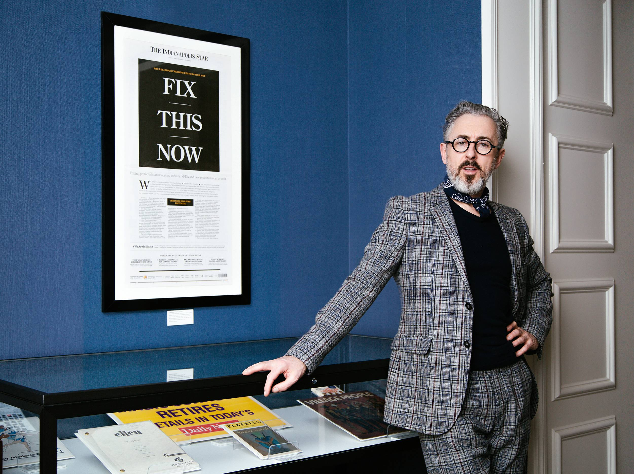 "Alan Cumming poses next to artifacts he selected for the ""Newsroom: Rise Up"" suite at the Hamilton Hotel in Washington, D.C."
