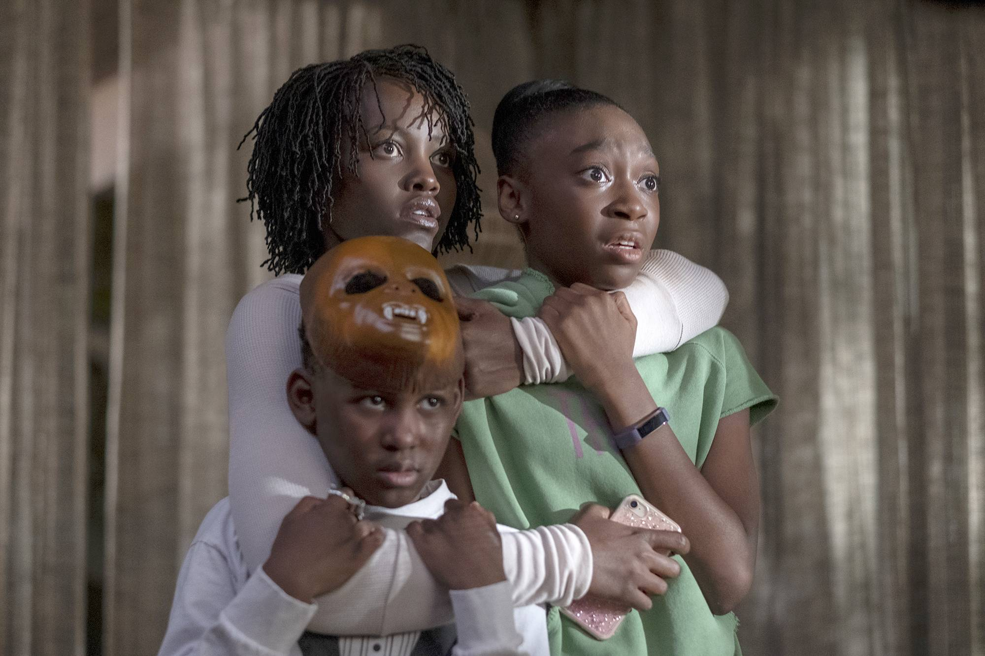 "Evan Alex, left, Lupita Nyong'o and Shahadi Wright Joseph star in ""Us,"" written, produced and directed by Jordan Peele."