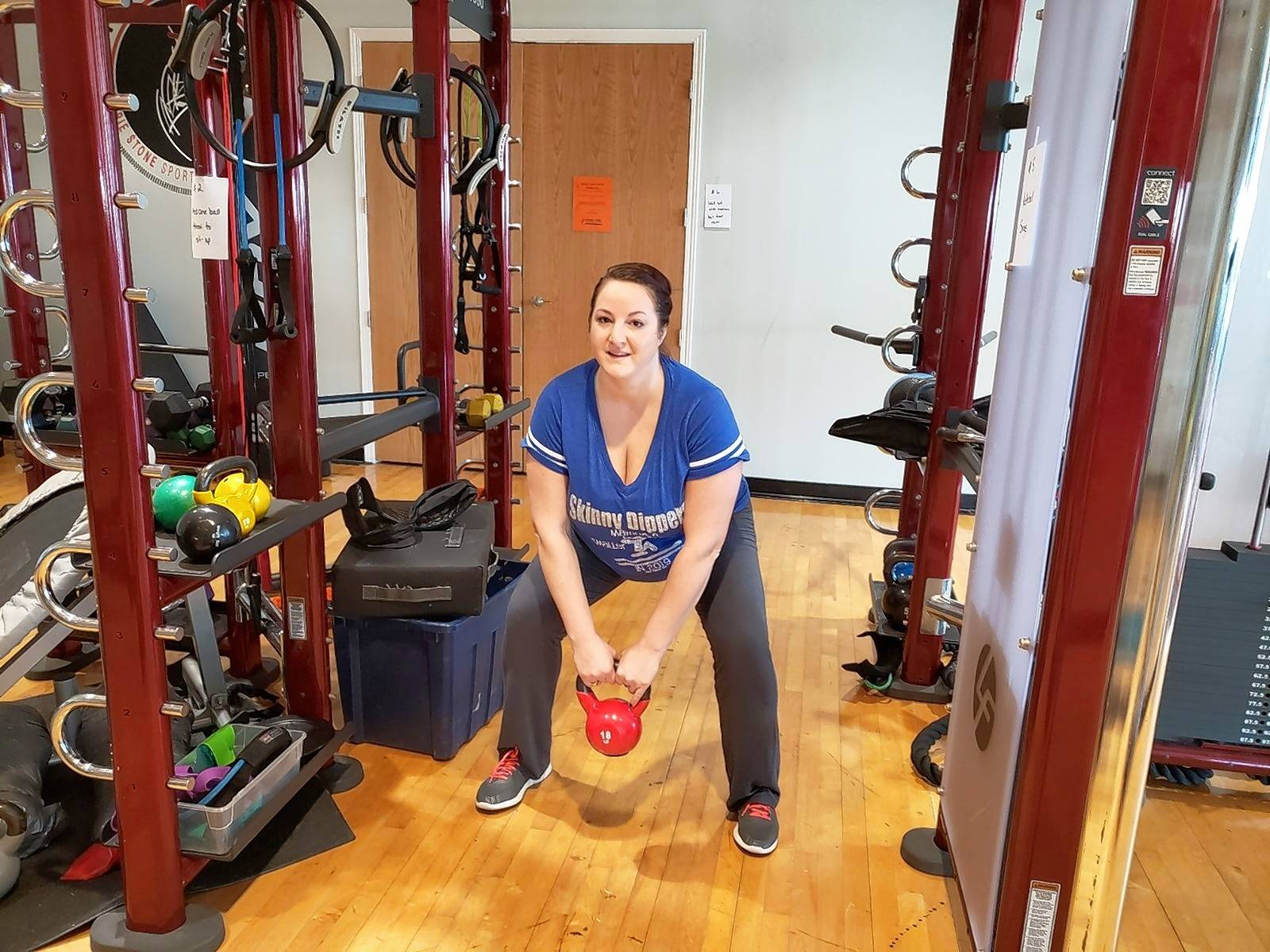 "Sonja Jacobson of Fitz Chem LLC's ""Skinny Dippers"" gets working on kettlebell squats at the circuit training workshop offered by Hoffman Estates Park District."