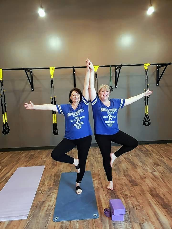 "Left, Barb Merner and Lori Tobler of ""Skinny Dippers"" of Fits Chem LLC. are growing at Push Fitness' Vinyasa class."
