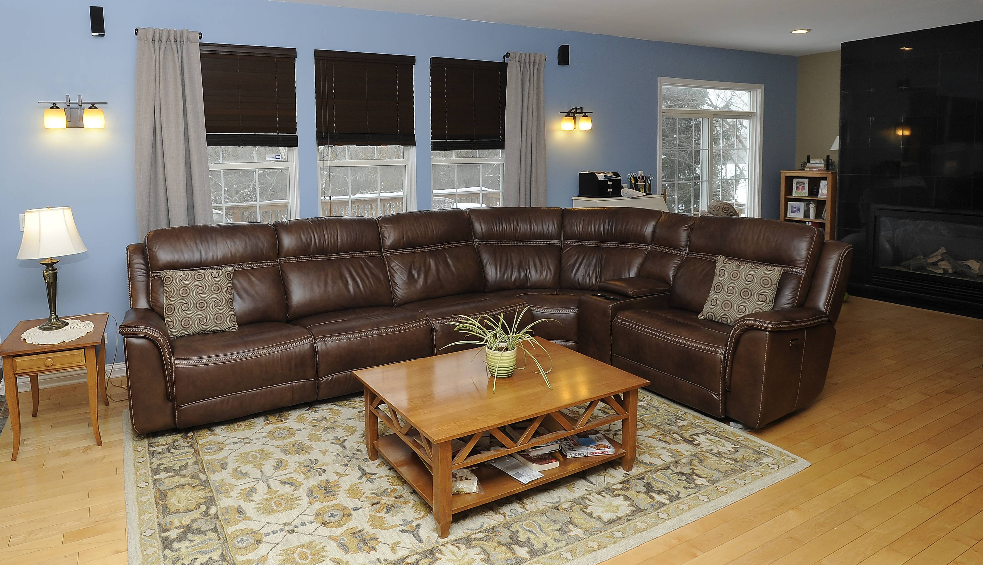 Claudia and Michael Fisher of Mundelein won a living room makeover that included a new couch and drapes for the family's living area.