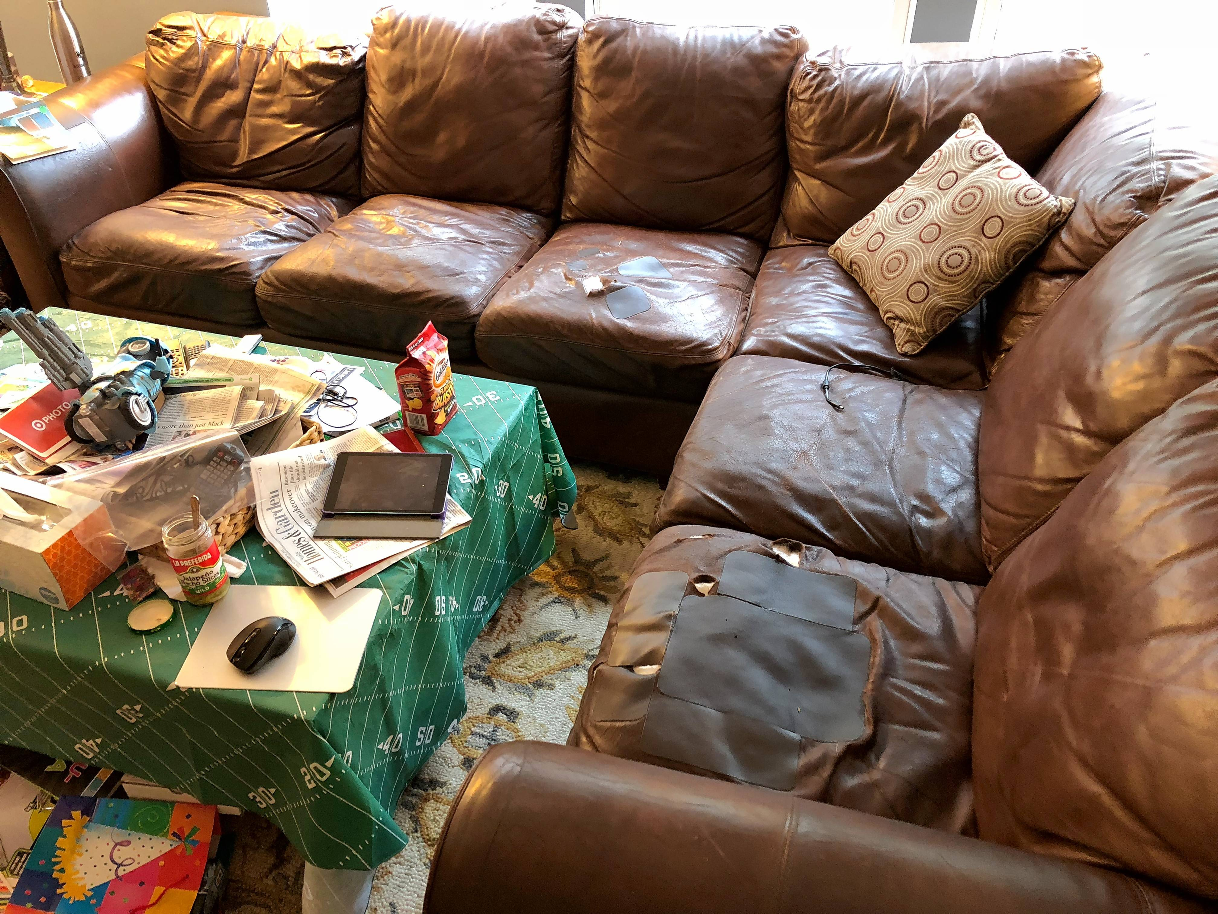 "The Fishers' old sectional was well loved but also well worn. ""The next step is duct tape,"" Michael wrote in his contest entry."