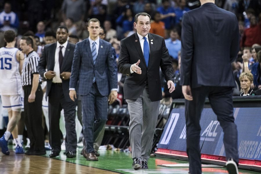 Duke coach Mike Krzyzewski prepares to shake hands with North Dakota State coach David Richman Friday after a first-round game in the NCAA Tournament in Columbia, South Carolina. Duke defeated North Dakota State 85-62.