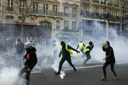 Teargas is used to disperse demonstratos during minor clashes with police in Paris, Saturday, March 23, 2019. The French government vowed to strengthen security as yellow vest protesters stage a 19th round of demonstrations, in an effort to avoid a repeat of last week's riots in Paris.