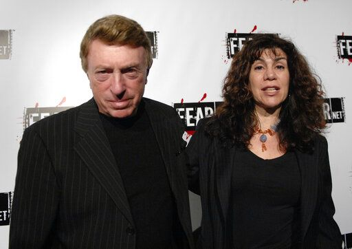 "File-This Oct. 30, 2006, file photo shows writer, director Larry Cohen, left, and wife Cynthia Cohen arriving for the Comcast, Sony and Lionsgate launch party for FEARnet, a multi-platform network dedicated to horror, held at the Boulevard 3 nightclub in Los Angeles.  Cohen, the maverick B-movie director of cult horror films ""It's Alive"" and ""God Told Me To,"" has died. He was 77. Cohen's friend and spokesman, the actor Shade Rupe, said Cohen passed away Saturday, March 23, 2019, in Los Angeles surrounded by loved ones."