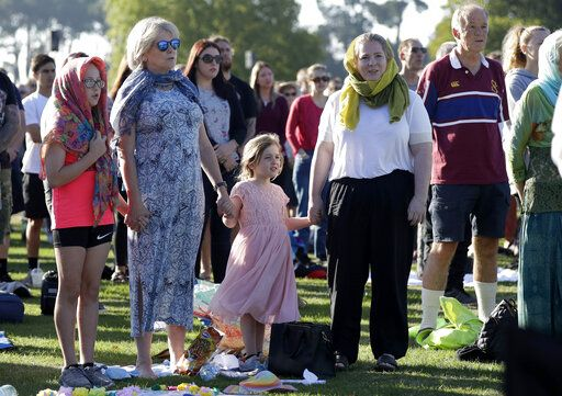People attend a vigil in Hagley Park following the March 15 mass shooting in Christchurch, New Zealand, Sunday, March 24, 2019.