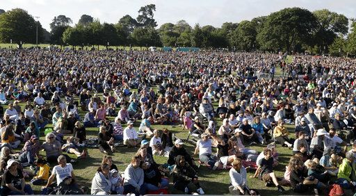 People gather for a vigil in Hagley Park following the March 15 mass shooting in Christchurch, New Zealand, Sunday, March 24, 2019.