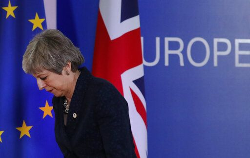 British Prime Minister Theresa May leaves after addressing a media conference at an EU summit in Brussels, Friday, March 22, 2019. Worn down by three years of indecision in London, EU leaders on Thursday were grudgingly leaning toward giving the U.K. more time to ease itself out of the bloc.