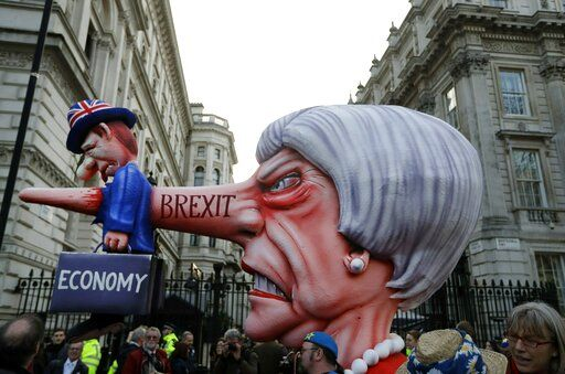 An effigy of British Prime Minister Theresa May passes by Downing Street during a Peoples Vote anti-Brexit march in London, Saturday, March 23, 2019. Anti-Brexit protesters swarmed the streets of central London by the tens of thousands on Saturday, demanding that Britain's Conservative-led government hold a new referendum on whether Britain should leave the European Union.